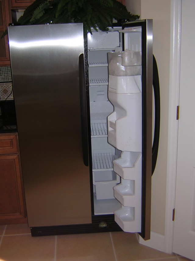 French Door Refrigerator Against A Wall
