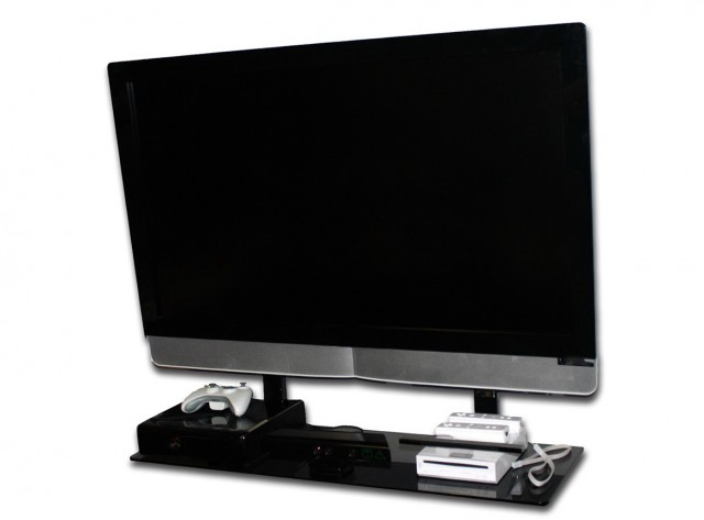 Flat Screen Tv With A Mount And Shelf