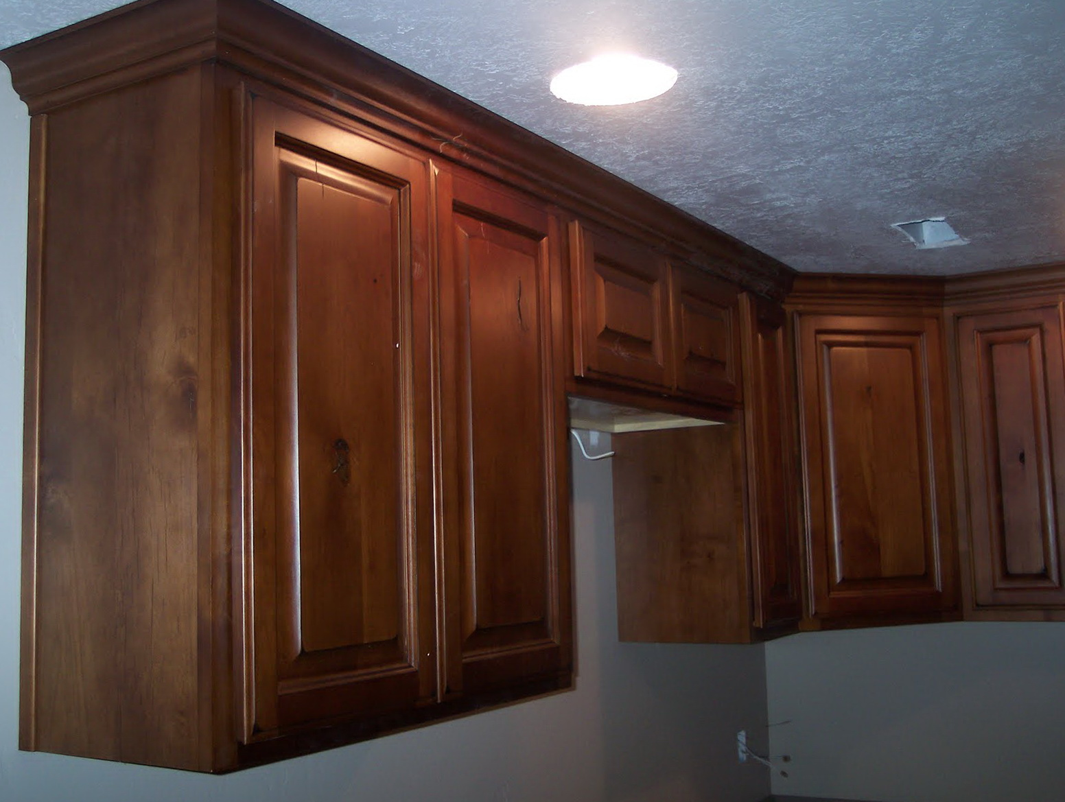 Dark Stained Knotty Alder Cabinets