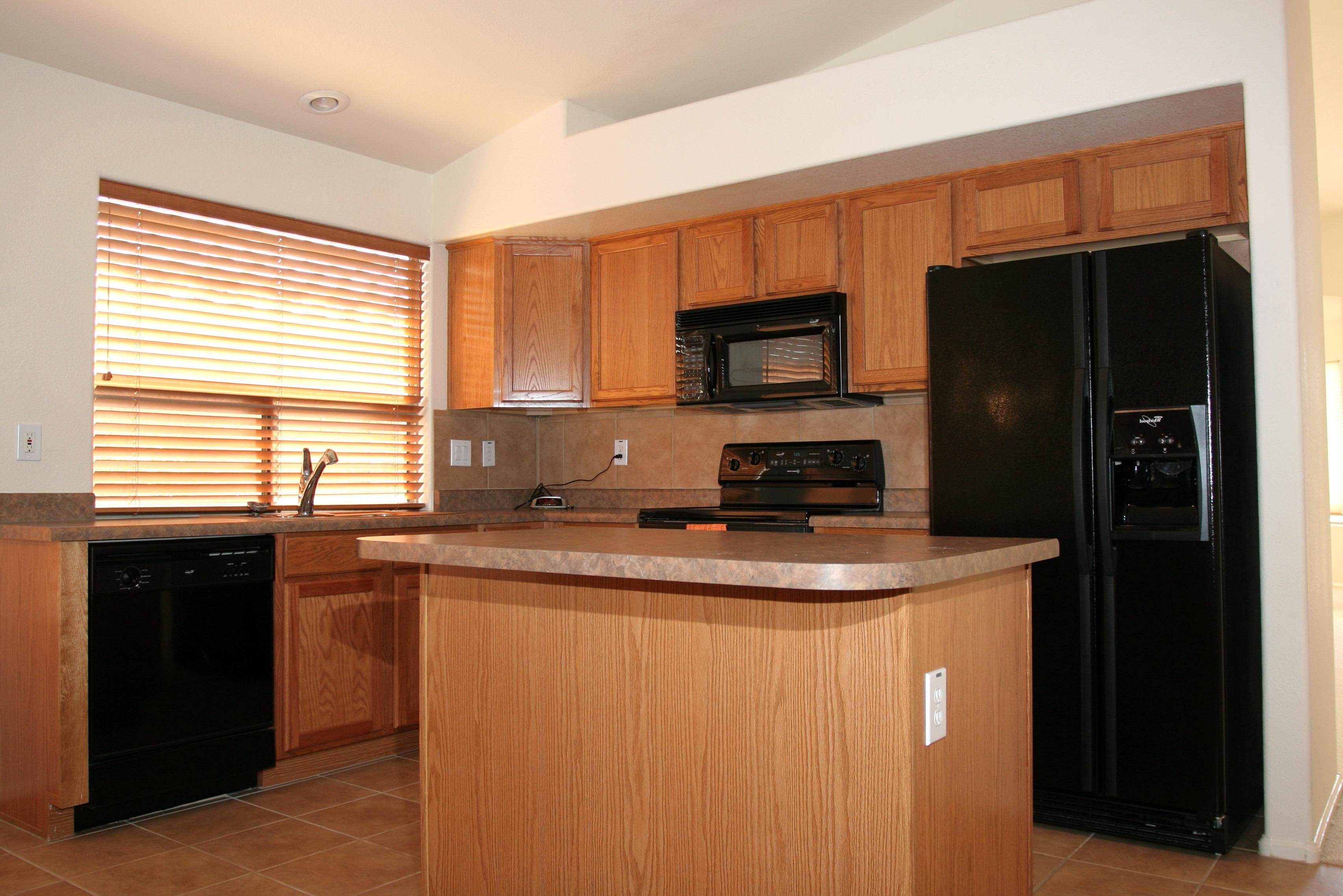 Oak Kitchen Cabinets With Black Appliances